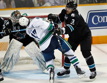 Vancouver Canucks Ryan Kesler is checked by San Jose Sharks Douglas Murray (R) during the second period of Game 4 in their NHL Western Conference Final hockey playoff game in San Jose, California, on May 22, 2011. (REUTERS)