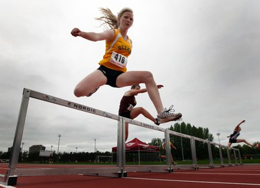 0FSAA2011_EAST_300HURDLES - May 26, 2011  - Glebe Collegiate Institutes' Adara Dillabaugh competes in the 300M hurdles during the OFSAA East Regionals at Terry Fox Athletic Facility Thursday, May 26, 2011.  (DARREN BROWN/QMI AGENCY)