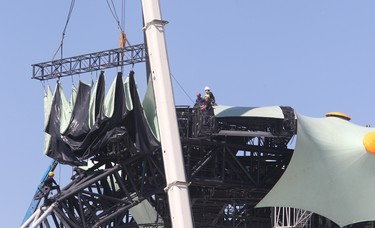 Riggers work on the U2 stage in Winnipeg Thursday May 26, 2011 in preparation for Sunday's concert. (BRIAN DONOGH/Winnipeg Sun)