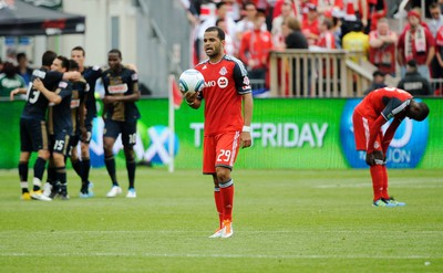 Toronto FC's Maicon Santos walks with the ball after Philadelphia Union scored during the first half of their MLS soccer game in Toronto on May 28, 2011. (REUTERS)