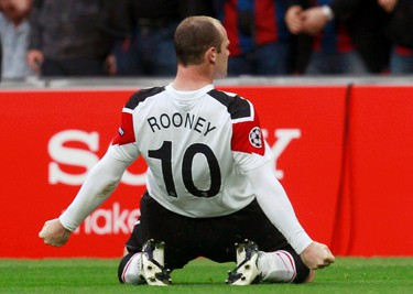 Manchester United's Wayne Rooney celebrates a goal against Barcelona during their Champions League final soccer match at Wembley Stadium in London on May 28, 2011. (REUTERS)