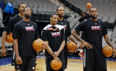 Miami Heat players (L-R) Dexter Pittman, Dwyane Wade, Mario Chalmers, Udonis Haslem, and LeBron James stand together during practice for the NBA Finals basketball series against the Dallas Mavericks in Dallas, Texas on June 6, 2011. (REUTERS)