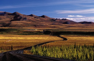 The Dempster Highway is Canada's only all-season public road to cross the Arctic Circle. This 736 km unpaved two-lane highway ranks among the world's most unique driving routes. (QMI Agency file photo)