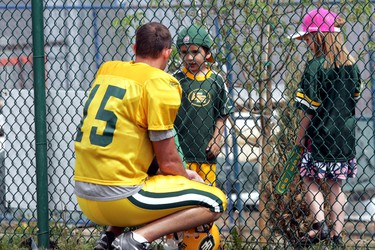 Edmonton Eskimos Ricky Ray stops during practice to speak some young fans at Esks Fan Day at Clarke Park in Edmonton on Saturday, June 11, 2011. (PERRY MAH/EDMONTON SUN)