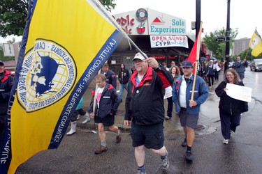 Canada Post employees gather at McIntyre  Park in Edmonton on Tuesday, June 14, 2011.   The postal workers held a strike rally  and march from the park along Whyte ave.        PERRY MAH/EDMONTON SUN  QMI AGENCY