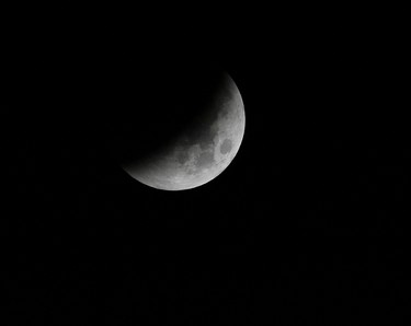 A shadow falls on the moon during a total lunar eclipse as seen at the University of the Philippines PAG-ASA Astronomical Observatory in Manila on June 16, 2011. (REUTERS/Cheryl Ravelo)