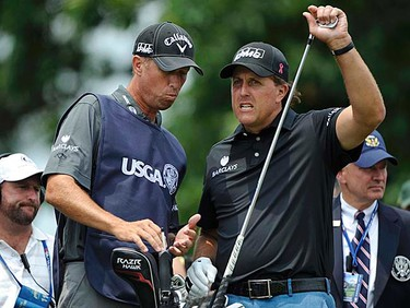 Phil Mickelson (right) of the U.S. speaks with his caddie, Jim Mackay on the 10th tee during the first round of the 2011 U.S. Open at Congressional Country Club in Bethesda, Maryland, Thursday, June 16, 2011. (REUTERS/Jonathan Ernst)