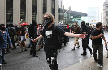 In this 2010 G20 file photo, anarchists break away from the main demonstration. (STAN BEHAL/Toronto Sun/QMI Agency)