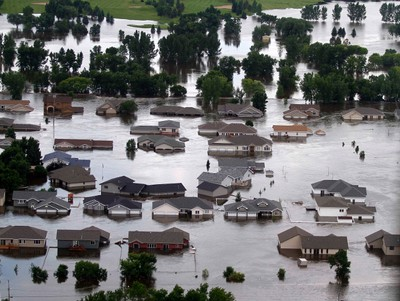 Newer housing are flooded on the southwest side of Minot, North Dakota as the Souris River spills over levees and dikes June 25, 2011. Flood projections forecast the Souris River to crest today.(REUTERS/Allen Fredrickson)