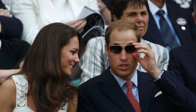 Britain's Catherine, Duchess of Cambridge sits in the Royal Box on Centre Court with her husband Prince William, for the match between Andy Murray of Britain and Richard Gasquet of France at the Wimbledon tennis championships in London June 27, 2011. REUTERS/Suzanne Plunkett