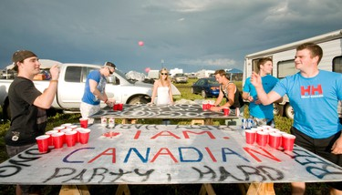 Jarrad Cook, Rob Carter, Jenny Brodeur, Devin Wedick, Matt Proulx and Jordan Retelback play a game of beerpong on their homemade tables on the opening day of Boonstock on Wednesday June 29, 2011 in Gibbons, Alta. PHOTO BY CANDICE WARD/EDMONTON SUN  QMI AGENCY