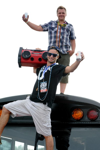 Steven Scoby and Chris Stefaniuk stand on top of their party bus Thursday June 30, 2011 in Gibbons, Alta., during day two of Boonstock. PHOTO BY CANDICE WARD/EDMONTON SUN  QMI AGENCY