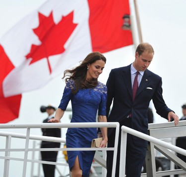 Britain's Prince William and his wife Catherine, Duchess of Cambridge disembark the Canadian naval patrol frigate HMCS Montreal in Quebec City July 3, 2011.  REUTERS