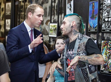 Britain's Prince William talks during a tour of the Maison Dauphine in Quebec City July 3, 2011.  REUTERS/Mathieu Belanger
