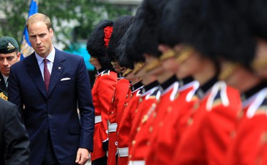 Britain's Prince William inspects the honour guard during a Freedom of the City ceremony at city hall in Quebec City July 3, 2011.   REUTERS/Christinne Muschi