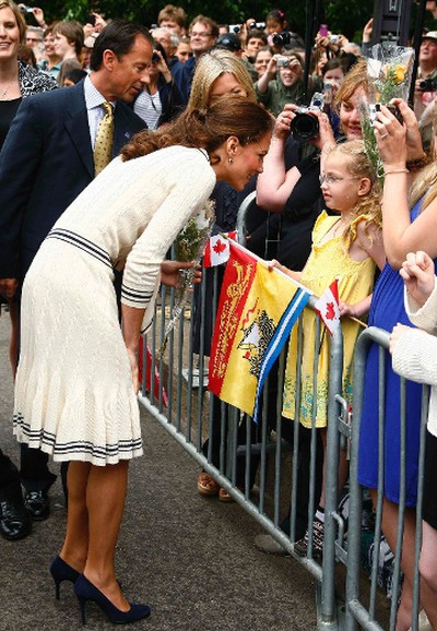 Catherine, the Duchess of Cambridge, speaks to a girl on Great George street  in Charlottetown, P.E.I., July 4, 2011.  REUTERS/Paul Darrow