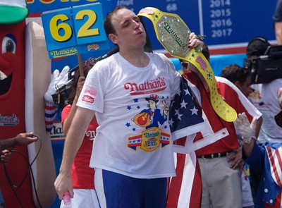 Joey Chestnut wins first place with 62 hot dogs in ten minutes in the 2011 Nathan's Famous Fourth of July International Hot Dog Eating Contest at Coney Island, Brooklyn, New York July 4, 2011. REUTERS/Allison Joyce
