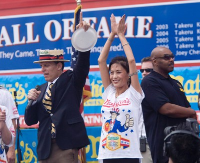 Juliet Lee wins second place eating 29 hot dogs in ten minutes in the Women's 2011 Nathan's Famous Fourth of July International Hot Dog Eating Contest at Coney Island, Brooklyn, New York July 4, 2011. REUTERS/Allison Joyce