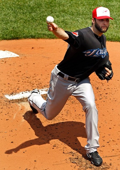 Toronto Blue Jays' starting pitcher Brandon Morrow pitches against the Boston Red Sox during the first inning of their MLB American League baseball game at Fenway Park in Boston, Massachusetts on July 4, 2011. (REUTERS)