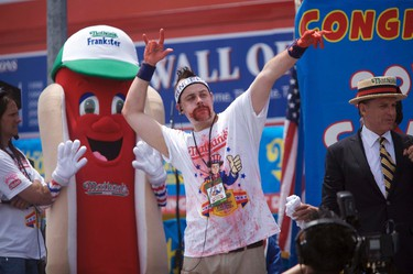 Pat Bertoletti wins second place with 53 hot dogs in ten minutes in the 2011 Nathan's Famous Fourth of July International Hot Dog Eating Contest at Coney Island, Brooklyn, New York July 4, 2011. REUTERS/Allison Joyce