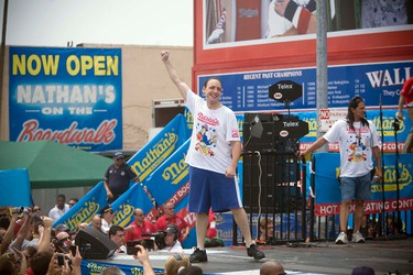 Joey Chestnut competes in the 2011 Nathan's Famous Fourth of July International Hot Dog Eating Contest at Coney Island, Brooklyn, New York July 4, 2011. REUTERS/Allison Joyce