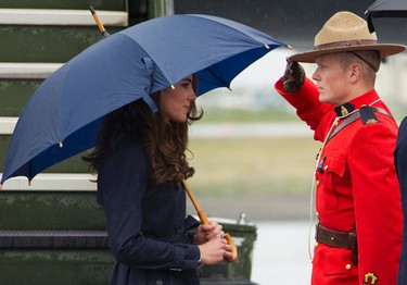 Catherine, Duchess of Cambridge, is saluted by a Royal Canadian Mounted Police officer upon her arrival in Yellowknife, Northwest Territories July 4, 2011. Britain's Prince William and his wife Catherine are on a royal tour of Canada from June 30 to July 8. REUTERS/Andy Clark    (CANADA - Tags: ROYALS SOCIETY ENTERTAINMENT POLITICS MILITARY)