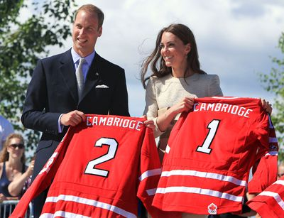 The Duke of Cambridge, Prince William and the Duchess Catherine hold hockey jerseys during a street hockey game in Yellowknife, N.W.T., July 5, 2011.  The newlywed royal couple are touring parts of Canada on their first official visit abroad and are spending a total of 9 days in Canada. (Andre Forget/QMI Agency)