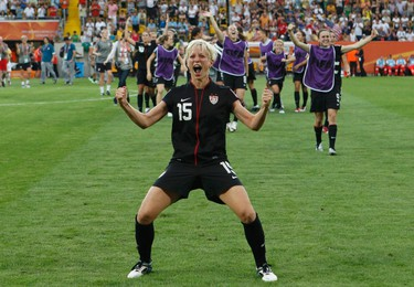 Megan Rapinoe of the U.S. celebrates with her teamamtes defeating Brazil after penalty shootout during their Women's World Cup quarter-final soccer match in Dresden on July 10, 2011.  (REUTERS)
