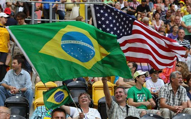 Fans wave the U.S. (R) and Brazil flags before the start of the Women's World Cup quarter-final soccer match between both teams in Dresden on July 10, 2011.  (REUTERS)