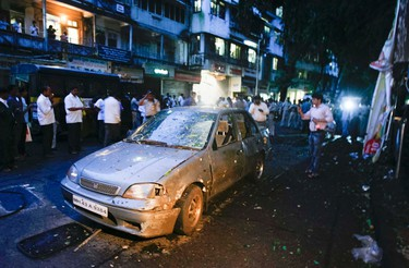 A car is seen damaged at the site of a bomb explosion in the Dadar area of Mumbai July 13, 2011. Three explosions rocked crowded districts of India's financial capital of Mumbai during rush hour on Wednesday, killing at least eight people, media said, in the biggest attack on the city since 2008 assaults blamed on Pakistan-based militants.    REUTERS/Stringer