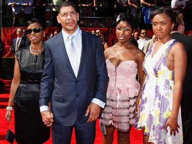 Dewey Bozella (second left) arrives with family members at the 2011 ESPY Awards in Los Angeles on July 13, 2011. Bozella, who was freed in 2009 after his wrongful conviction for a 1977 murder in the city of Poughkeepsie, N.Y., spent 26 years behind bars at the Ossining prison and was involved in the boxing program there. Bozella will receive the Arthur Ashe Courage Award at the awards show. (REUTERS/Danny Moloshok)