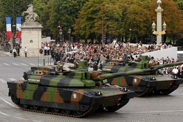 French army Leclerc tanks from the 12th Cuirassier Regiment drive down the Champs-Elysees during the Bastille Day parade in Paris, July 14, 2011. REUTERS/Benoit Tessier