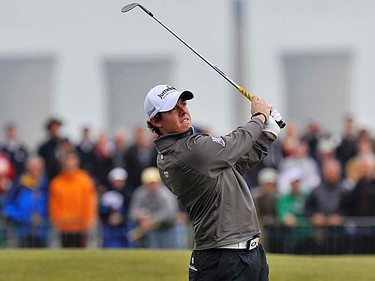 Rory McIlroy of Northern Ireland plays a shot on the first hole during the first round of the British Open at Royal St. George's in Sandwich, England on July 14, 2011. (REUTERS/Toby Melville)