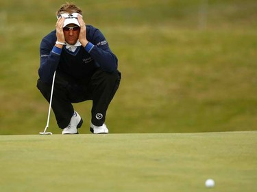 Ian Poulter of England lines up his putt on the second green during the first round of the British Open at Royal St. George's in Sandwich, England on July 14, 2011. (REUTERS/Eddie Keogh)