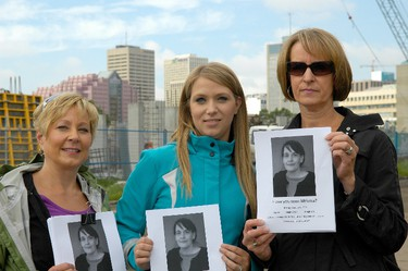 Tammy Kasteel (left), along with co-workers Erica Elzen and Mary Limes, spent part of Thursday, July 14, 2011 postering the east end of Edmonton's downtown wtih posters hoping that someone would know what happended to 44-year-old Melissa Ekkelenkamp. The missing woman walked away from Alberta Hospital on July 6.  IAN KUCERAK/EDMONTON SUN/QMI AGENCY
