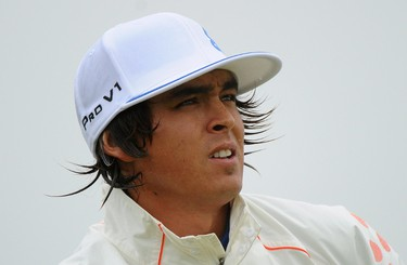 Rickie Fowler of the U.S. watches his tee shot on the third hole during the third round of the British Open golf championship at Royal St George's in Sandwich, southern England July 16, 2011.  REUTERS/Kieran Doherty