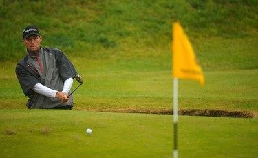 Anders Hansen of Denkark chips onto the eighth green during the third round of the British Open golf championship at Royal St George's in Sandwich, southern England July 16, 2011.  REUTERS/Russell Cheyne (BRITAIN  - Tags: SPORT GOLF)