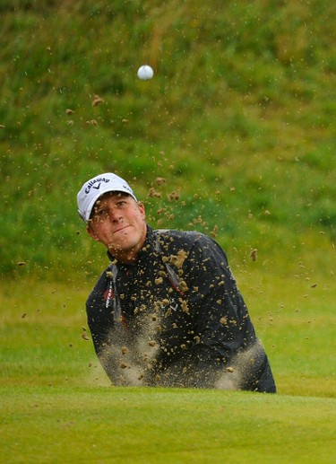 Fredrik Jacobson of Sweden plays out of a bunker on the eighth hole during the third round of the British Open golf championship at Royal St George's in Sandwich, southern England July 16, 2011.  (REUTERS)