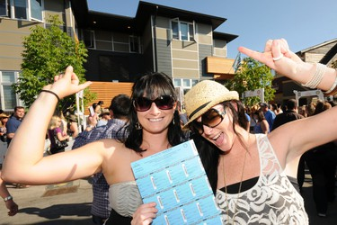 Kim Logan and Michelle Souliere pick up their tickets for the 2011 Rotary Dream Home at the Stampede grounds on July 16, 2011. CANDICE WARD/SPECIAL TO QMI AGENCY