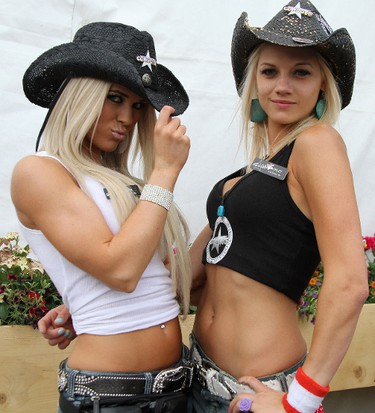 It wasn't all about the rodeo. There was plenty of beer going around at the Stampede. Here we get a glimpse of Erin and Ashley at the Cowboys Stampede Tent, July 9. BRENDAN MILLER/Special to QMI Agency