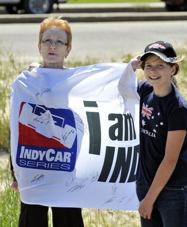 The Indy Race convoy started at Kingsway Ave and 121 St in Edmonton, Alberta, as it took scenic route through the city, the drivers were greeted by a number of enthusiastic fans waving cameras and flags on July 19, 2011. RYAN MCLEOD/EDMONTON SUN/QMI AGENCY