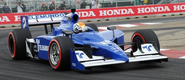 Orial Servia rounds turn one during the qualifying round of IZOD IndyCar Series at the Edmonton Indy at the City Centre Airport on July 23, 2011 in Edmonton, AB. Sato CANDICE WARD/EDMONTON SUN  QMI AGENCY