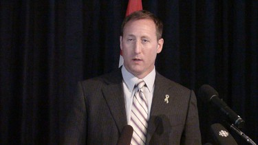 Peter MacKay was in Winnipeg Tuesday, July 26, 2011 to express his support for the Winnipeg Jets logo � and to announce more funding for health care at Winnipeg's air force base. (TAMARA KING/Winnipeg Sun)