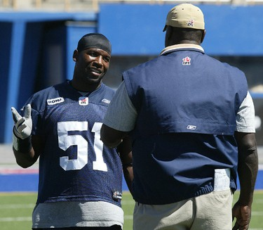Barrin Simpson works with the defensive line coach Richard Harris during practice at Canad Inns Stadium Wednesday, August 1, 2007. (Winnipeg Sun files)
