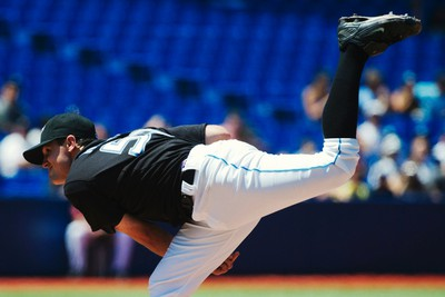 Toronto Blue Jays pitcher Brad Mills throws to the Texas Rangers during the third inning of their MLB American League baseball game in Toronto July 30, 2011. (REUTERS)