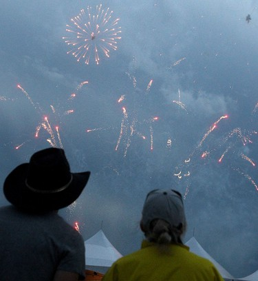 Concert-goers watch the fireworks after finding out that the Toby Keith performance had been cancelled on the final day of the Big Valley Jamboree in Camrose, AB on July 31, 2011. LAURA PEDERSEN/EDMONTON SUN QMI AGENCY
