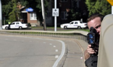 Constable Eric Theuser conducts speed enforcement over the long weekend at 75th Avenue and 101st Street in Edmonton, Alberta, on August 1, 2011. RYAN MCLEOD/EDMONTON SUN/QMI AGENCY