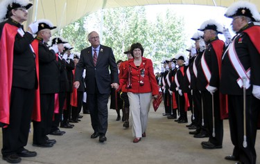 Alberta Lieutenant Governor, Colonel Donald Ethell (left), Mrs. Linda Ethell enter the ceremony as Knights of Columbus opened the citizenship ceremony at Hawrelak Park. 118 people from 59 countries were part of the ceremony as part of Heritage Festival in Edmonton, Alberta, on August 1, 2011. RYAN MCLEOD/EDMONTON SUN/QMI AGENCY