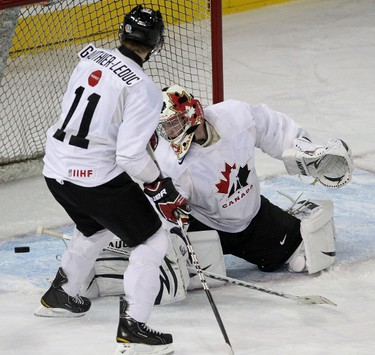 Team White's Jerome Gathier-Leduc (left) and goalie Scott Wedgewood watch as the puck slides into the net during the scrimmage between Canada's National Junior Team spilt into Team Red and Team White during the Development Camp at Rexall Place in Edmonton, AB on August 4, 2011.  LAURA PEDERSEN/EDMONTON SUN QMI AGENCY