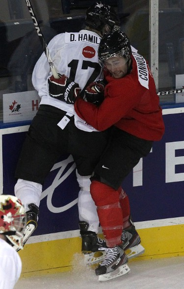 Team White's Dougie Hamilton (left) gets pushed into the boards by Team Red's Brett Connolly (right) during the scrimmage between Canada's National Junior Team spilt into Team Red and Team White during the Development Camp at Rexall Place in Edmonton, AB on August 4, 2011.  LAURA PEDERSEN/EDMONTON SUN QMI AGENCY